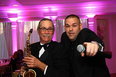 Jonathon Page in MC mode with fellow member and saxophone player, TexSax.