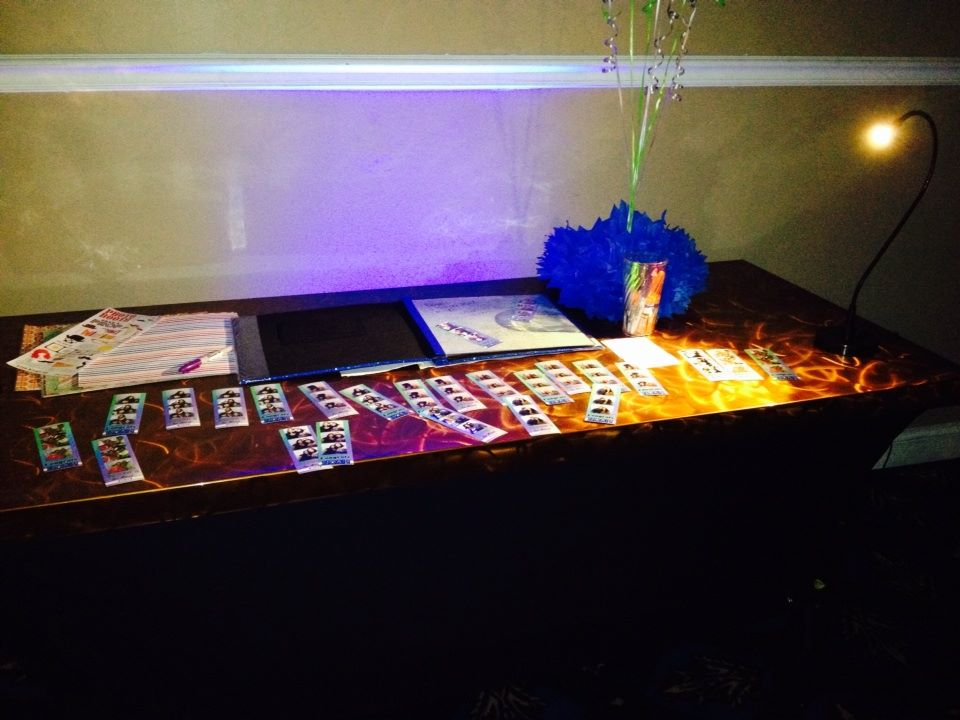 In addition to the photo booth itself, guests can enjoy scrapbook stations like this one.