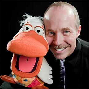 Ventriloquist Tom Crowl posing with his puppet, Dangerous